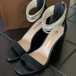 Audrey Brooke black and gold heels